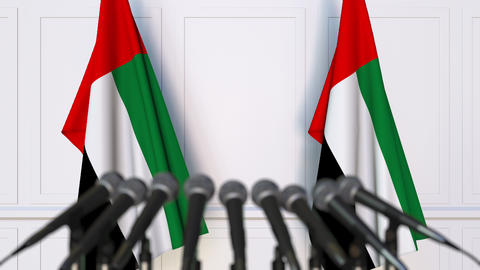 Official press conference. Flags of the United Arab Emirates UAE and microphones Footage