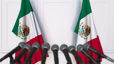 Mexican official press conference. Flags of Mexico and microphones. Conceptual Footage