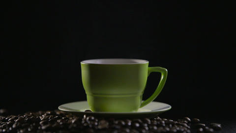 Cup Of Hot Coffee With Steam Over Black Background stock footage