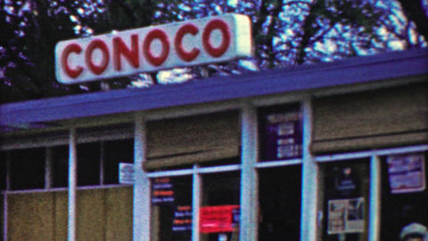 1959: Conoco gas service station sign commerical business storefront Footage