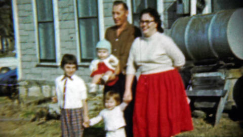 1959: Happy family poses gasoline fuel barrell front house Footage