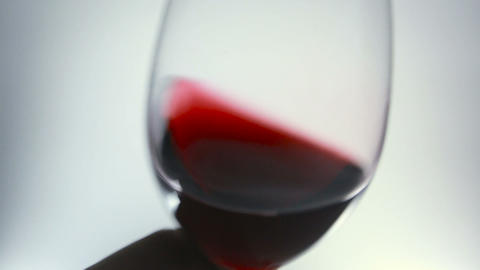 close-up of red wine swirling in a glass Footage