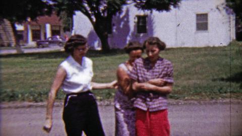 1959: Women laughing scared playing hyper black dog jumping Footage