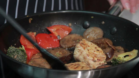 cooking vegetables and meat Footage