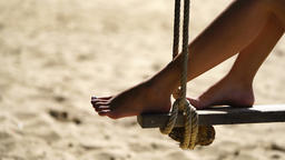 young woman relax on the swing at the beach closeup Archivo