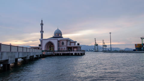 Timelapse day to night transition during low tide at the floating mosque Live Action