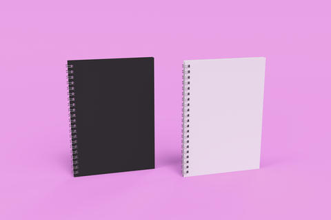 Two notebooks with spiral bound on violet background Photo