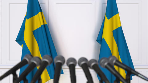 Swedish official press conference featuring flags of Sweden Footage