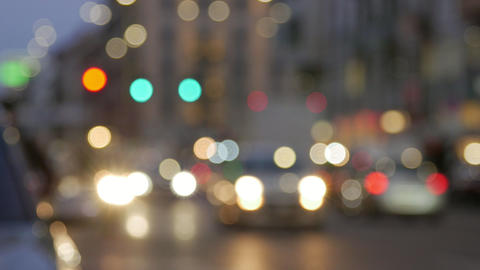 City at night background with cars. Out of focus background with blurry Footage