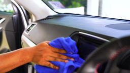 Auto service staff cleaning car interior Footage