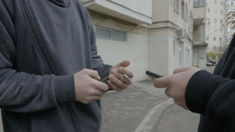 Client buying cocaine drugs at the corner of the street from a drug dealer who Footage