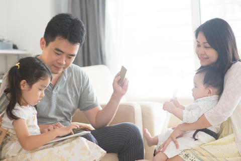 Asian family online shopping Photo