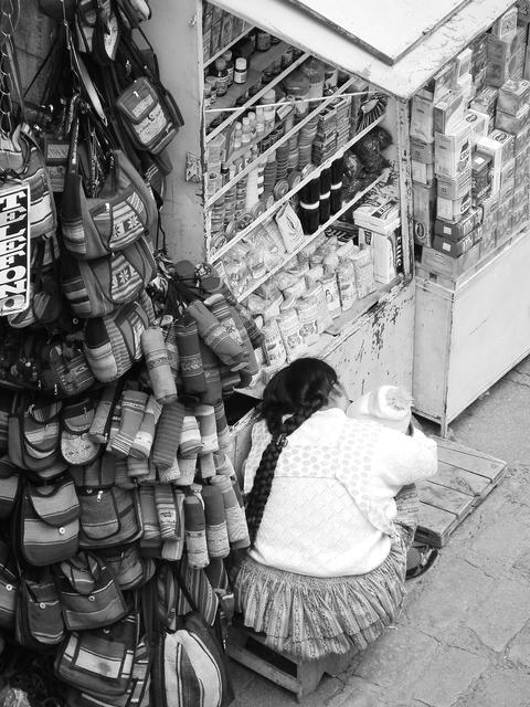 Bolivian woman holding her son on the streets of La Paz, Bolivia Photo