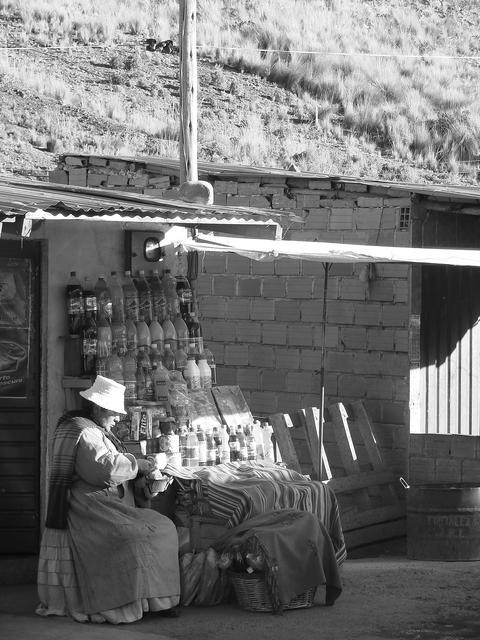 Bolivian woman sitting at her street shop. Aymara woman in Bolivia Photo