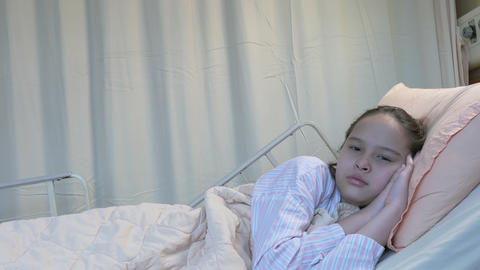 X-Sad Asian girl in hospital bed Footage