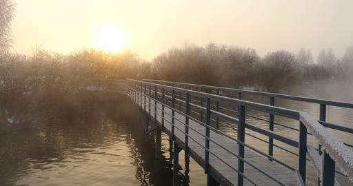 Lake pier in misty dawn in winter Footage