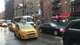 Yellow cabs and traffic on Manhattan street Footage