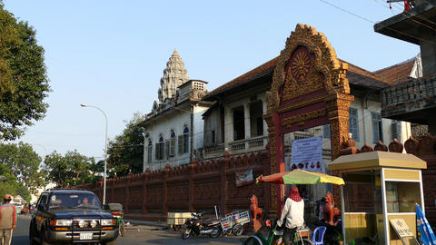 Traffic around Wat Ounalom in Phnom Penh Footage