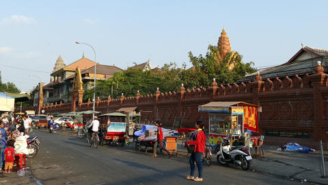Traffic in the street around Wat Ounalom in Phnom Penh Footage
