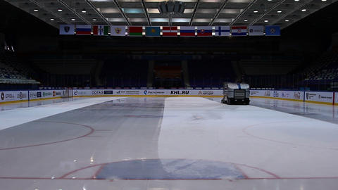 Preparation ice the game . The machine floods the ice. Hockey arena Footage