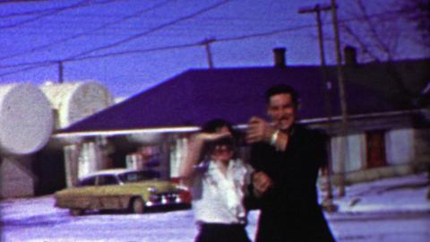 1958: Man smoking cigar drinking beer neighborhood bar older woman Footage