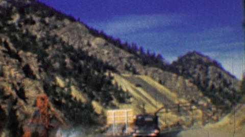 1958: Interstate highway 70 two lane road past mining tailings Footage