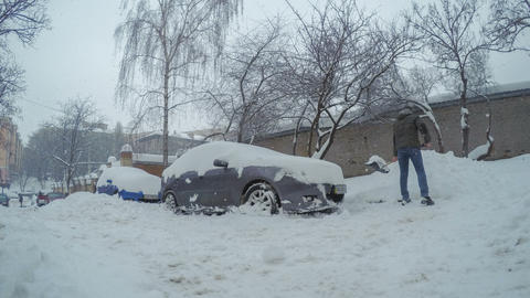 Man raked and removed the snow from his car Footage