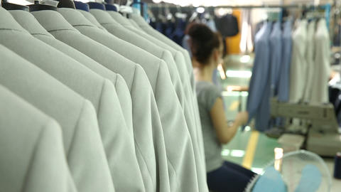 Dressmaker sews light men's suits Stock Video Footage