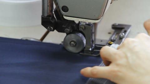 Seamstress works on the sewing machine Live Action