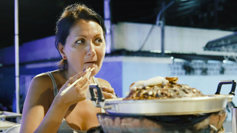 Woman eating seafood Live Action