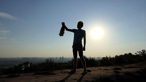 Young many raises many medals at sunset in summer in slo-mo Footage