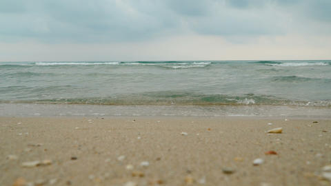 Low angle view of sea waves rolling ashore Footage
