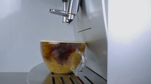 Pouring milk into a glass with coffee Footage
