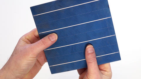 Solar Panel Cell Inspection in Two Hands Live Action
