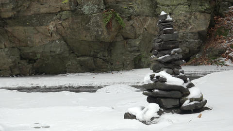 Stones on wintry river covered snows. Winter landscape. Stack of pebble stones Live Action