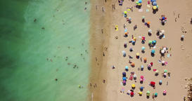 Aerial Drone View Of People On Beach In Portugal Image