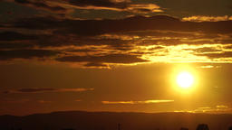 Wonderful sunset with bands of clouds, time lapse Footage