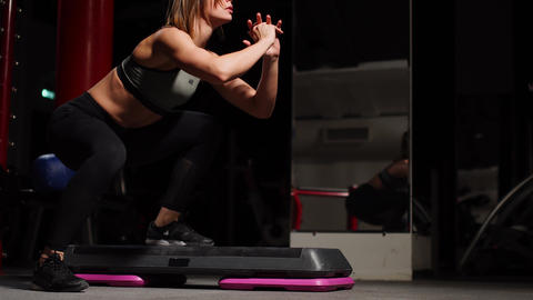 Fitness step, training, aerobics, sport concept - Athletic woman trainer at step Live Action