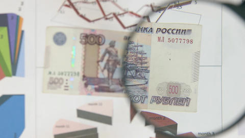 Rotating five hundred rubles and increase with a magnifying glass Footage