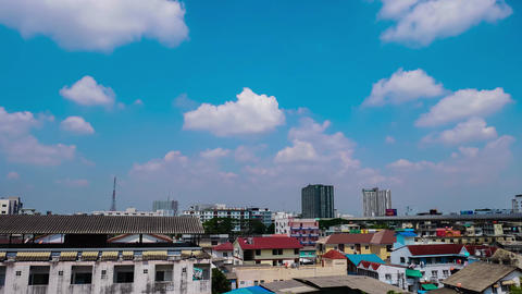 blue sky and the clouds are floating above the high buildings in the city Footage