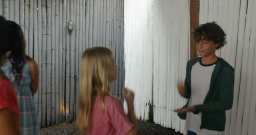 A boy and girl play rock paper scissors a game of chance... Stock Video Footage