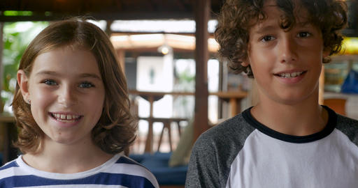 Portrait of a young pre teenage boy and girl age 11 - 12 smiling and looking at Footage