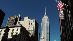 New York City 533 fifth avenue empire state building stars and stripes blue sky Footage