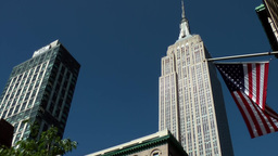 New York City 535 fifth avenue empire state building stars and stripes blue sky Footage