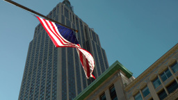 New York City 537 fifth avenue north side of empire state building with flag Footage