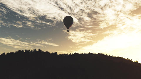 4K Hot Air Balloons Over Lush Natural Wilderness Jungle In The Sunset Sunrise 1 stock footage