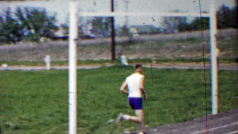 1958: Man leading high school track foot race long distance run Footage