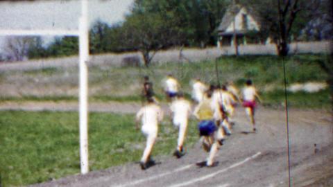 1958: Long distance high school track foot race rounding corner Footage