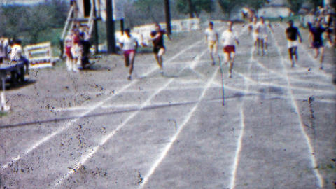 1958: High school boys running track end race finishing line fast Footage