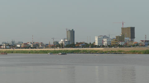Buildings at the Tonle Sap River side in Phnom Penh Footage